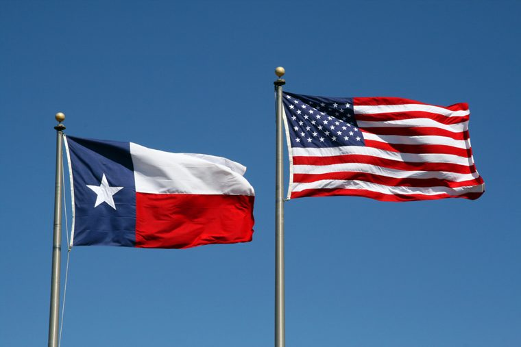 Texas Flag Flies At The Same Height As The Us Flag