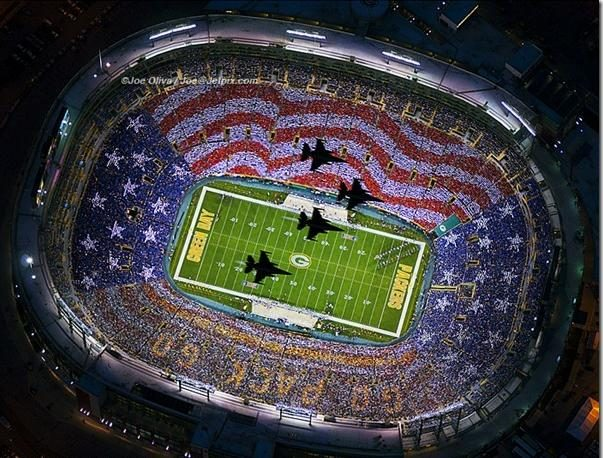 one photograph typically included with this item was not taken on the date of the veteran s day themed events at lambeau field but rather during the