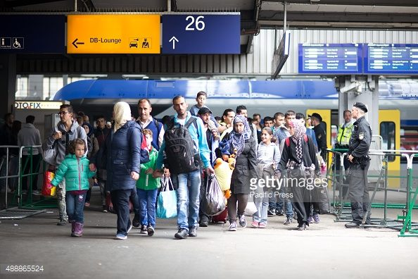 MUNICH CENTRAL STATION, MUNICH, BAVARIA, GERMANY - 2015/09/13: New arrivers enter the registration point. Even though Germany announced - and has by now - closed down its borders for refugees, asylum seekers keep coming to Munich Central Station. There is vast humanitarian support by the citizens of Munich. (Photo by Michael Trammer/Pacific Press/LightRocket via Getty Images)