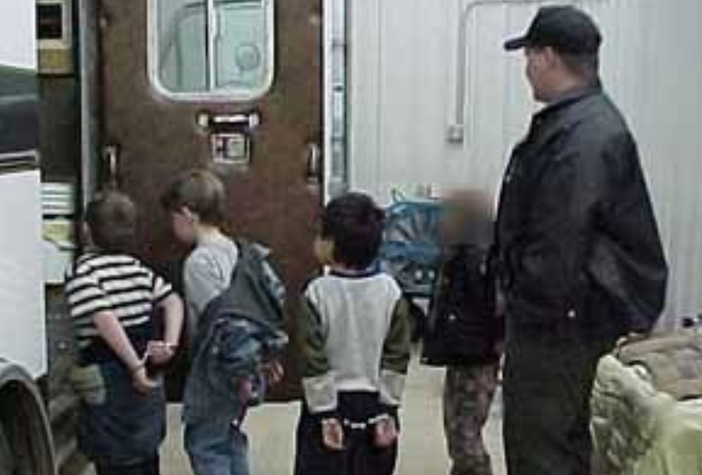 FACT CHECK: Does This Photograph Show ICE Arresting Small Children?