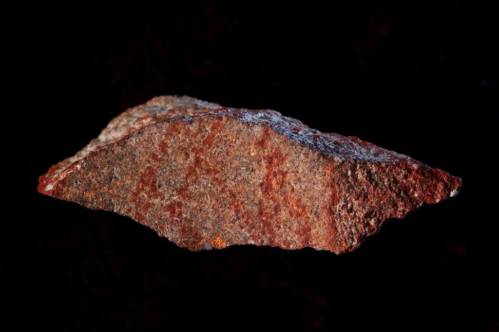 Stone in South African cave boasts oldest-known human drawing, resembles hashtag