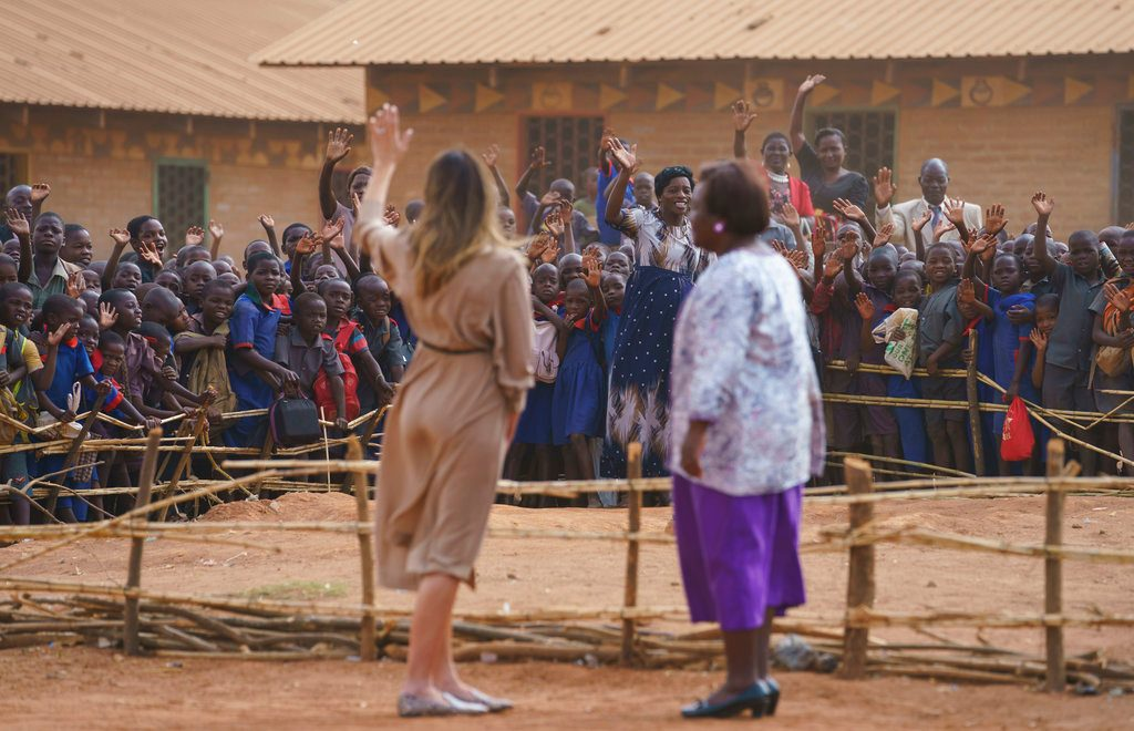 Melania Trump dances to African beat, feeds baby elephants