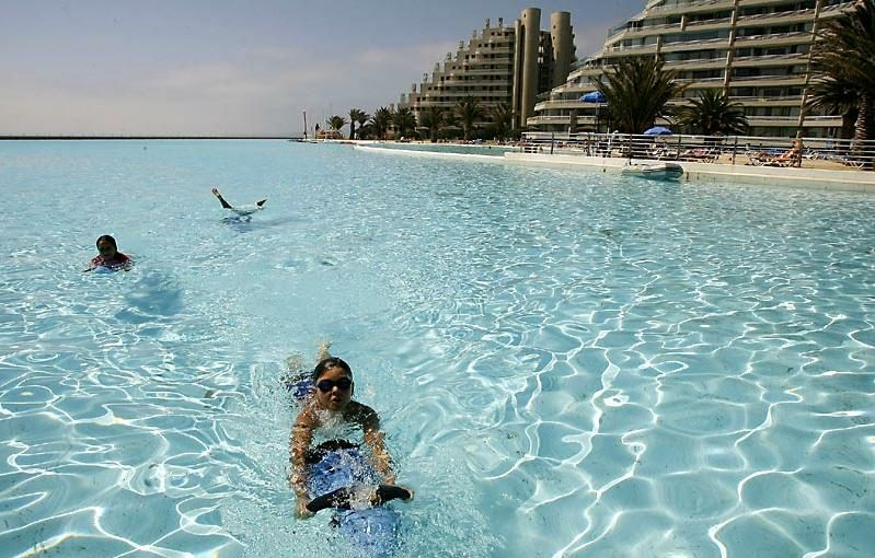 Origins: The Photographs Displayed Above Are, As Described, Pictures Of The  Worldu0027s Largest Swimming Pool: A Man Made, 3,324 Foot Long Salt Water  Lagoon At ...